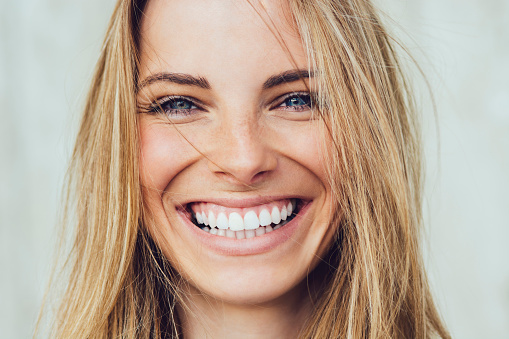 a woman smiling about her CO2 Laser Skin Resurfacing at Lehigh Oral and Maxillofacial Surgery